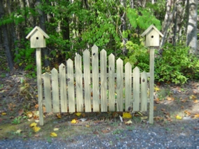 A cute birdfeeder fence for the garden.