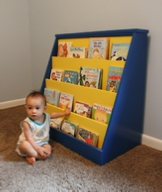 my son next to a bookcase I made