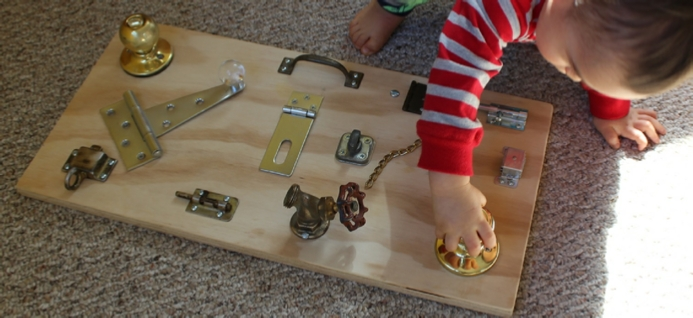 hinges and doorknobs keep toddler occupied
