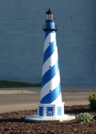 blue and white lawn lighthouse design