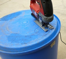 cutting hole for a rain barrel