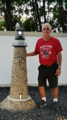 Larry standing next to his new lighthouse